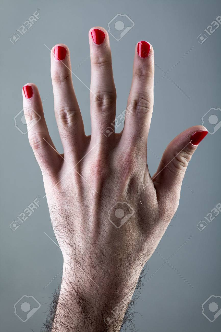Man\'s Hand With Red Nail Polish On Gray Background Stock Photo ...