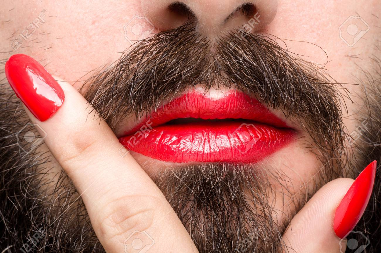 Bearded Man With Red Lipstick On His Lips And Nail Polish Stock ...