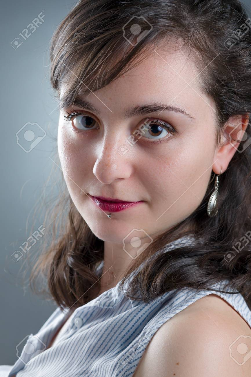 pretty girl with red lipstick and labret piercing stock photo