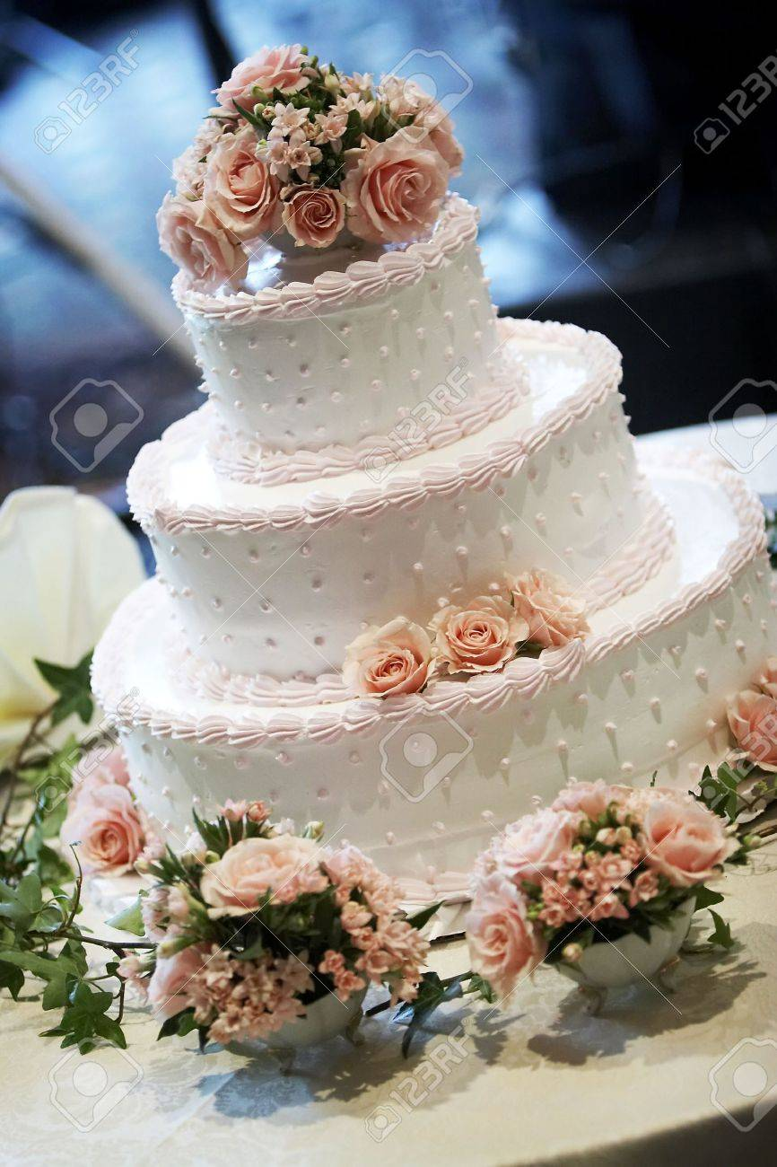 A Three Tiered Wedding Cake, Shallow Depth Of Field With The ...