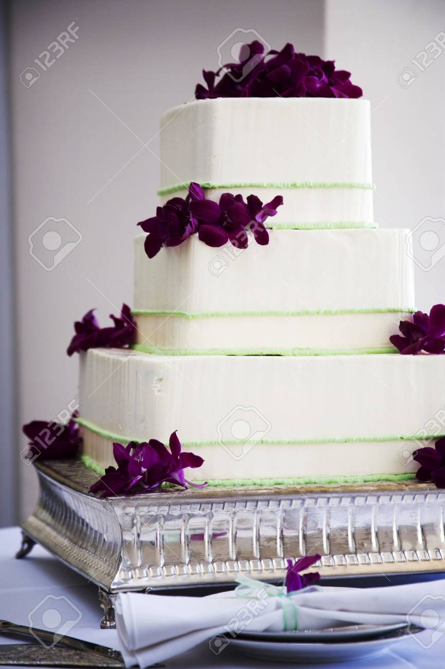 Wedding Cake With Three Tiers Green Stripes And Purple Flowers