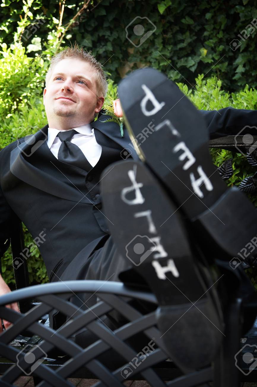 A groom with the words help on the bottom of his shoes. Focus is on his face Stock Photo - 2635129