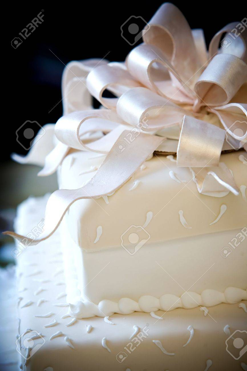 This Is A Very Cool Wedding Cake With Sugar Ribbons On Top Stock ...