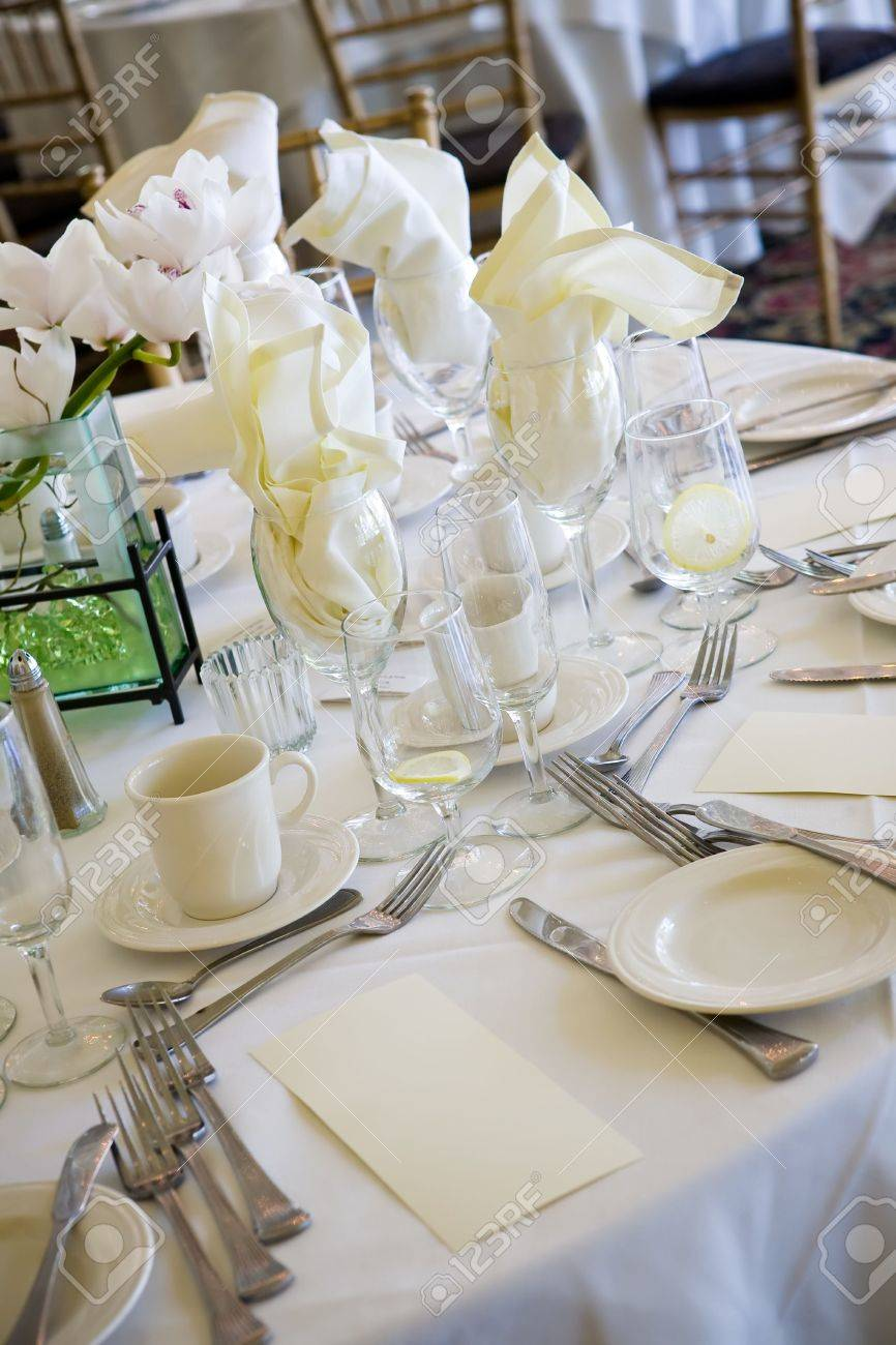 Fine dining restaurant table setup - Table Set Up For Fine Dining During A Catered Wedding Event Stock Photo 3507826