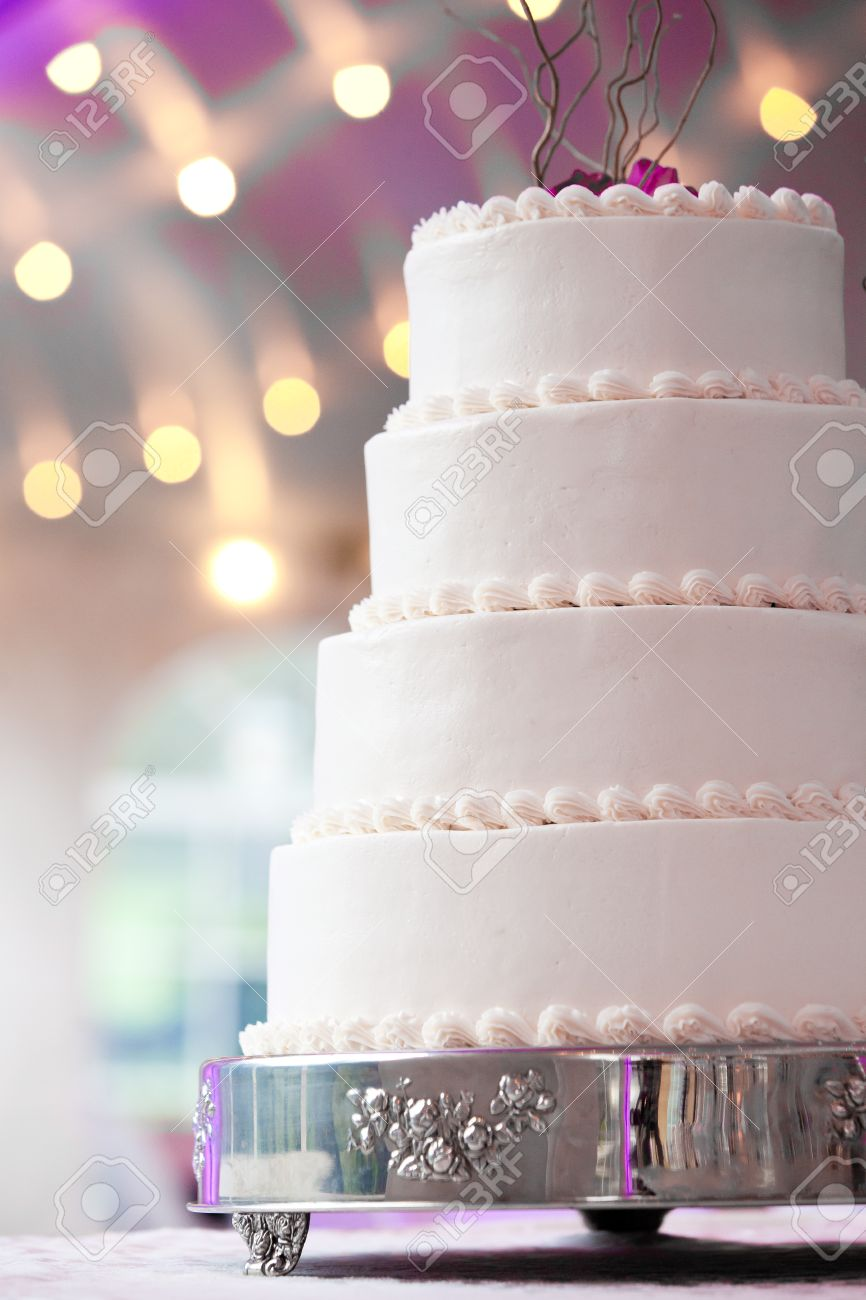 wedding cake with purple and lights in the background Stock Photo - 12820387