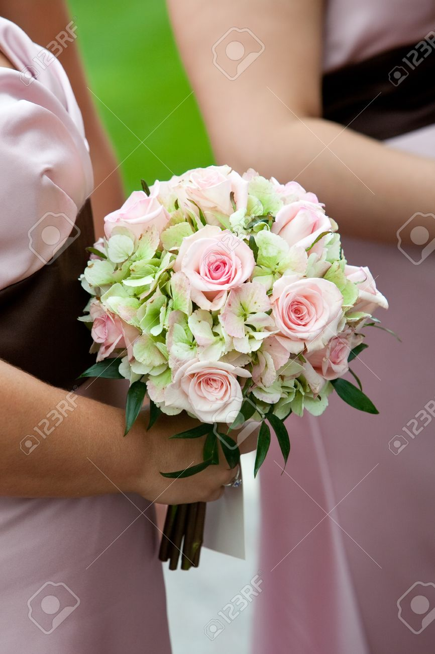Bridal Wedding Bouquet Of Flowers In White, Pink, And Green Stock ...