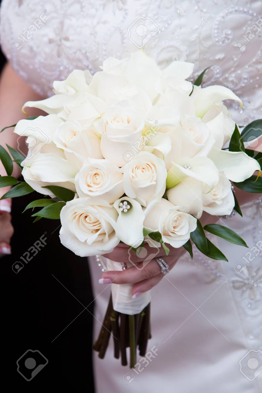 Bridal Wedding Bouquet Of Flowers In White And Green Held By Stock
