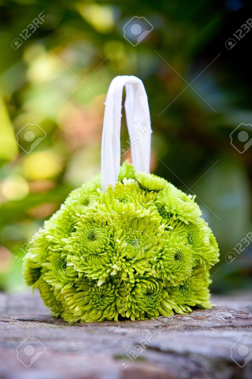 A Hanging Flower Ball Bouquet For A Flower Girl In Green Stock Photo ...