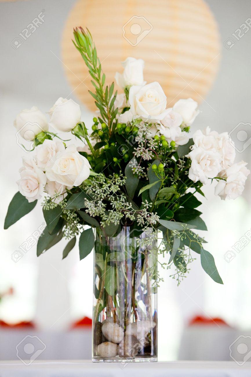 a large white wedding centerpiece on a table white roses stock rh 123rf com white rose centerpiece ideas white hydrangea centerpiece