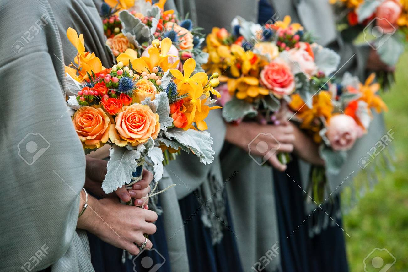Bridesmaids Holding Their Wedding Bouquets Of Flowers With Yellow Stock Photo Picture And Royalty Free Image Image 116891491
