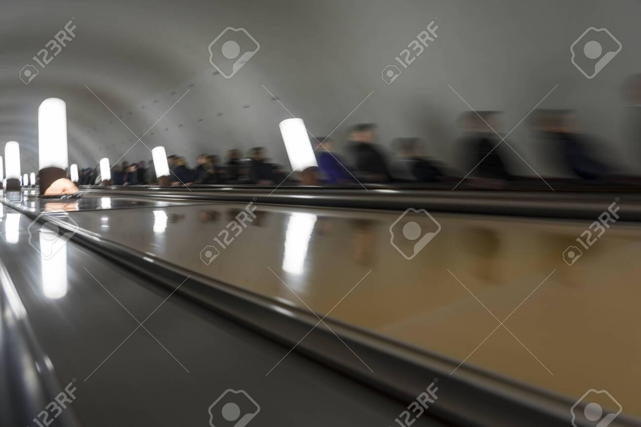 People on moving escalators. - 131587871