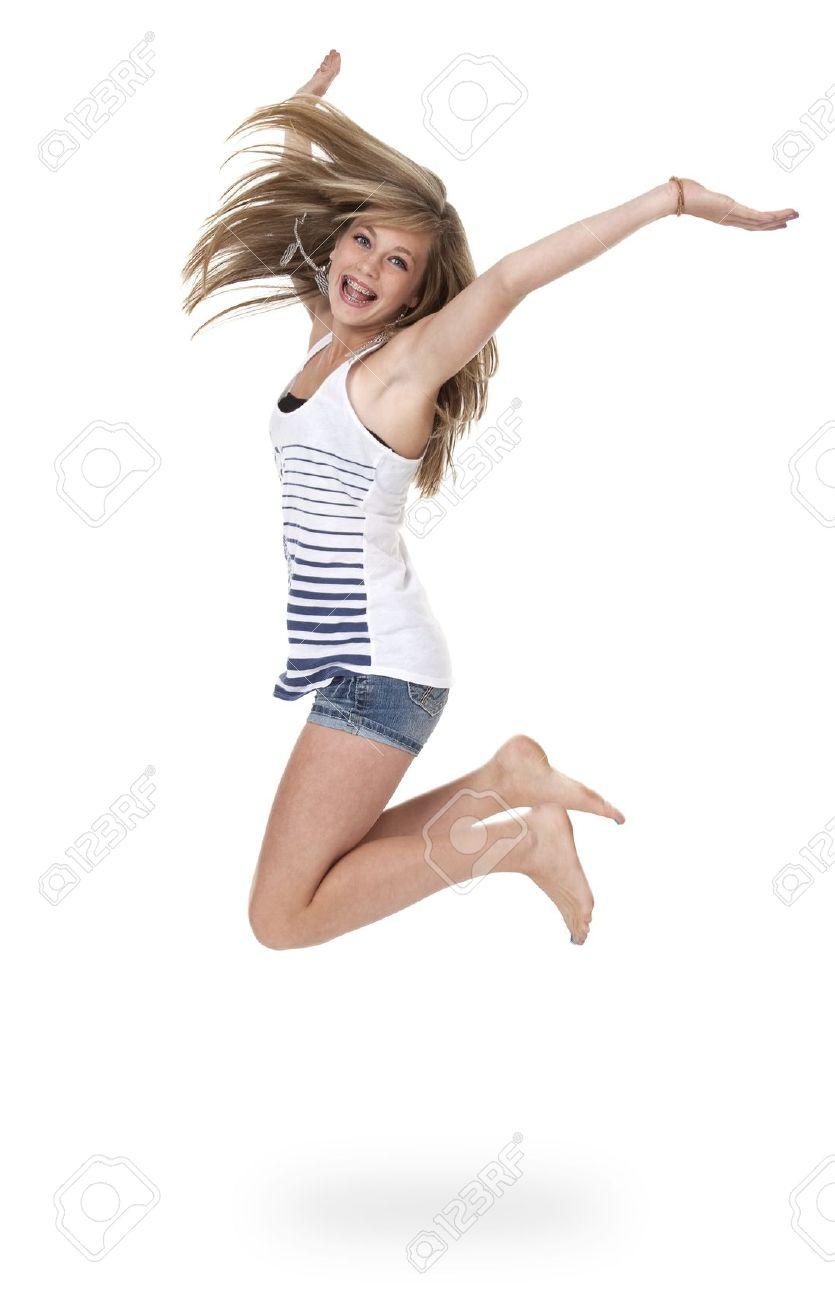 La Jolie Fille De L Air jolie fille de 14 ans sautant la mi-de l'air, isolé sur blanc.