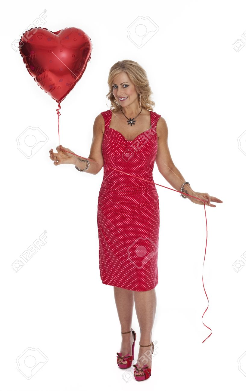 bd7cde38a Full length photo of 40 year old woman in red dress holding heart shaped red  balloon
