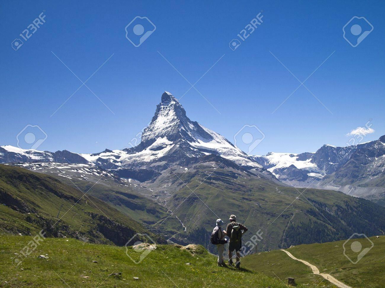 2 hiker on the hiking trail around mt matterhorn switzerland