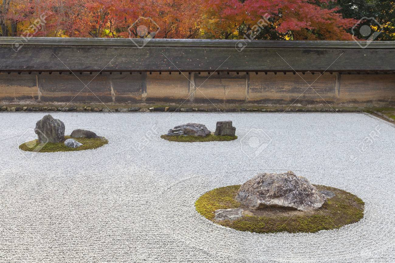 Attractive Japanese Dry Landscape Rock Garden In Autumn At Ryoanji (or Ryoan Ji),
