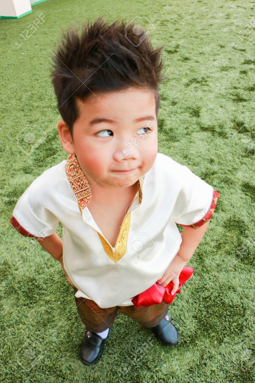 A Cute Boy In Thai Dress Stand On The Yard Stock Photo 72934070