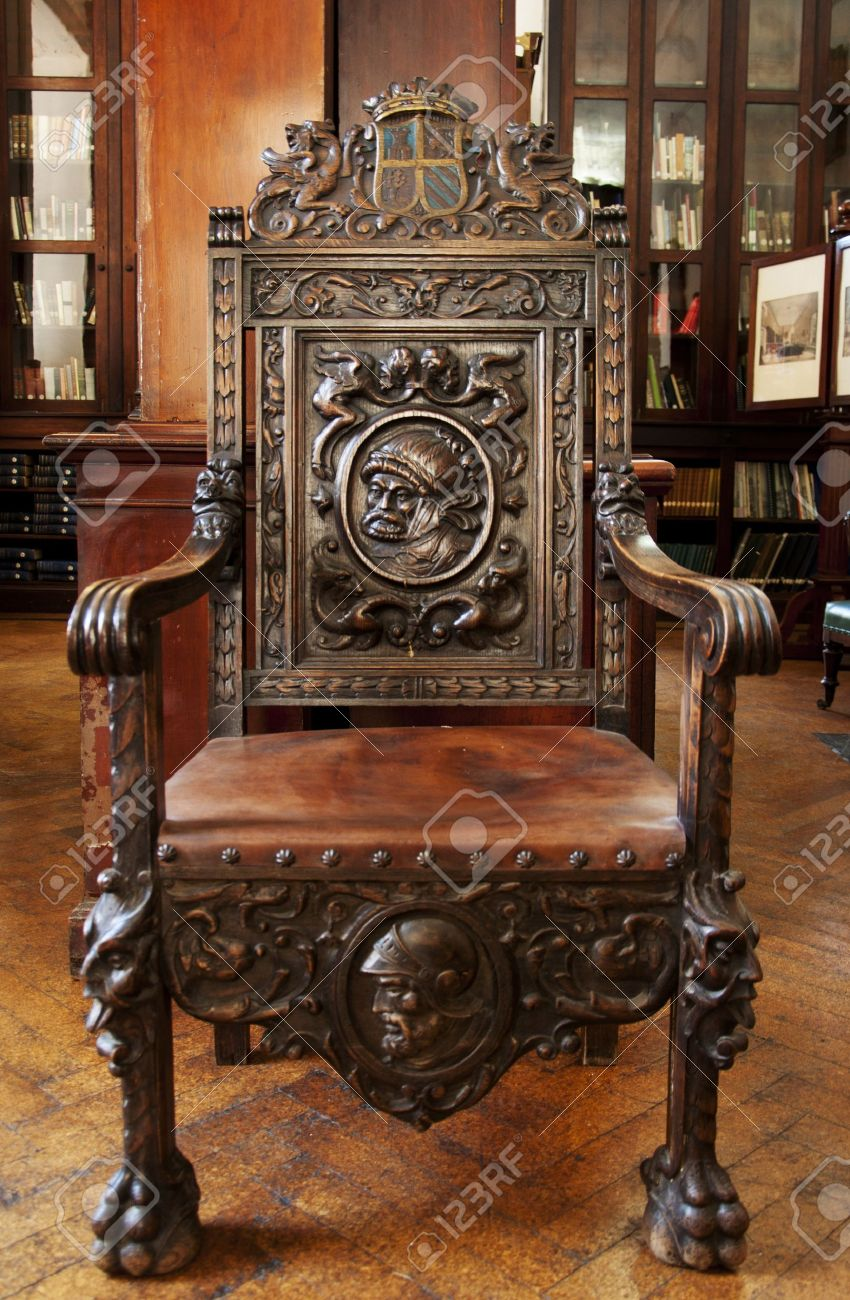 This antique wooden chair sits in the grand Garrison Library in Gibraltar.  Stock Photo - - This Antique Wooden Chair Sits In The Grand Garrison Library.. Stock