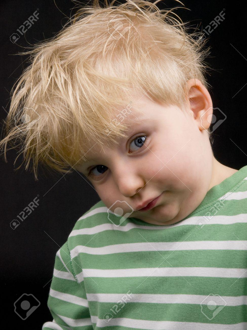 Little Boy Making Funny Face On Black Background Boy Have Blue