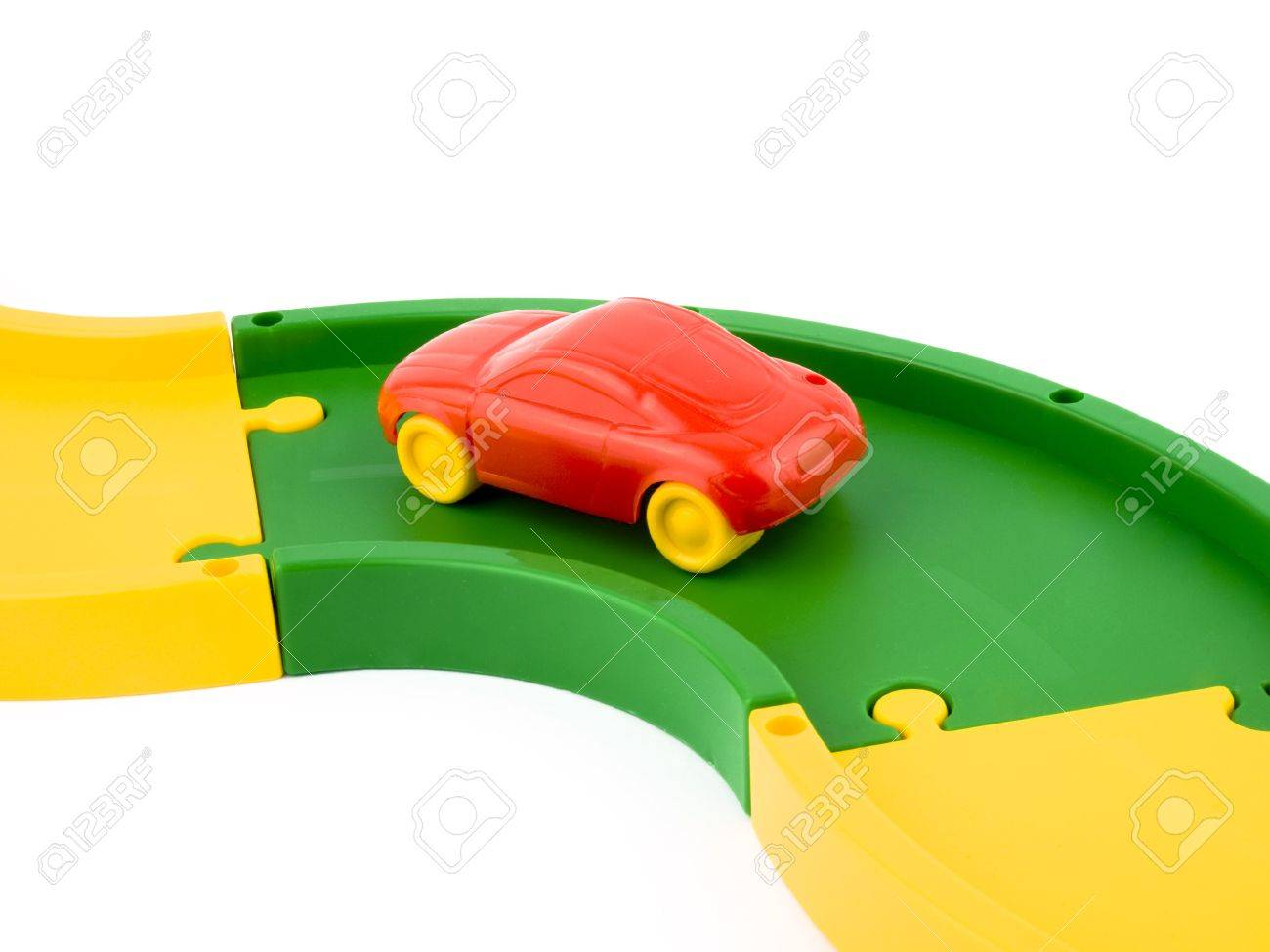 Small Red Toy Car On Plastic Road Stock Photo Picture And Royalty