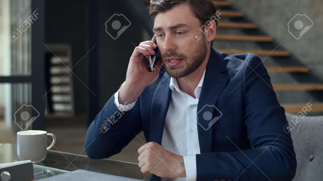 Portrait of angry businessman talking phone at home office emotionally. Closeup stressed business man calling on cell phone in slow motion. Frustrated man having problem on workplace. - 162270267