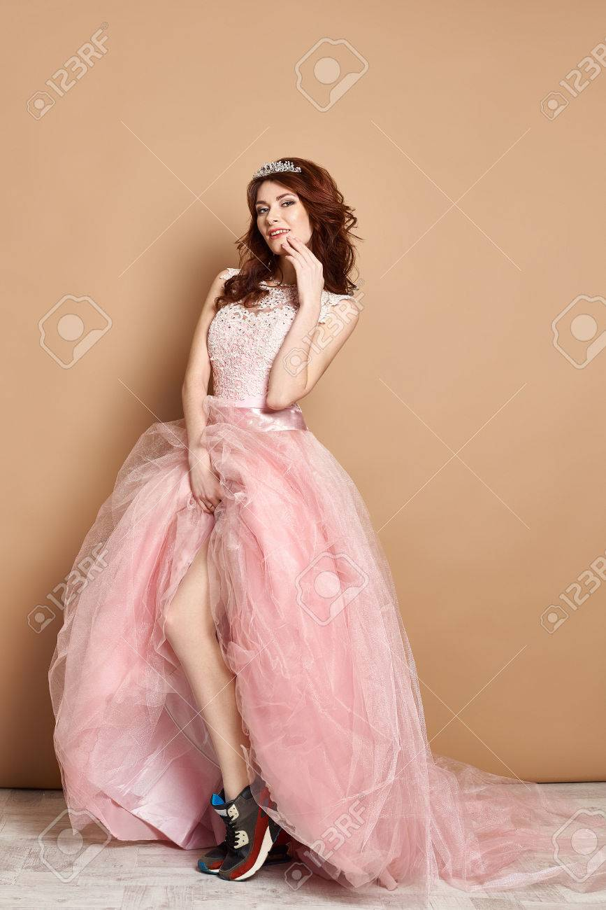 Foxy Queen Of The Prom In Pink Dress And Sneakers Stock Photo