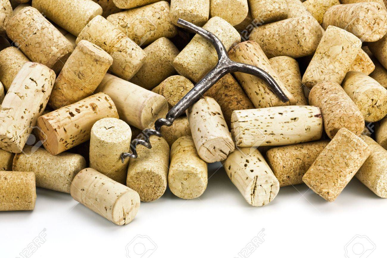 Old corkscrew on a heap of wine stoppers from bottles Stock Photo - 4545016