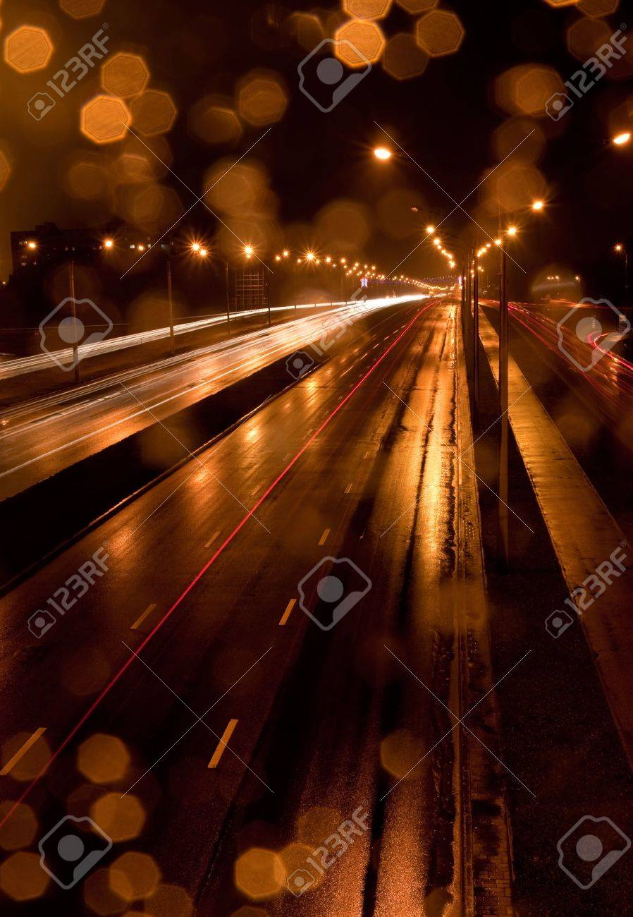 A night time shot of speeding traffic on a road Stock Photo - 6810620