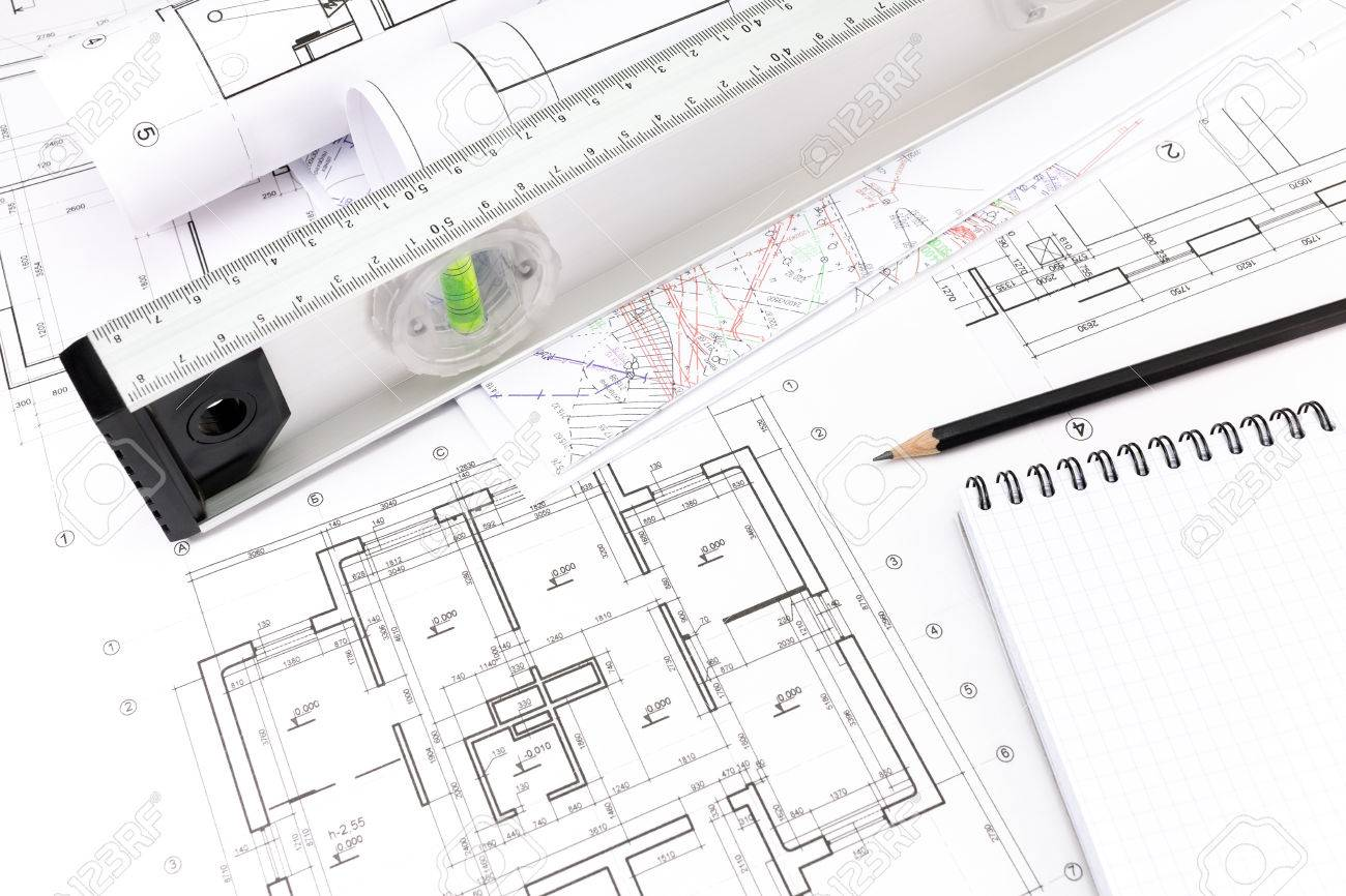 Architectural blueprints of new homes spirit level and notepad architectural blueprints of new homes spirit level and notepad with pencil stock photo 26969292 pooptronica
