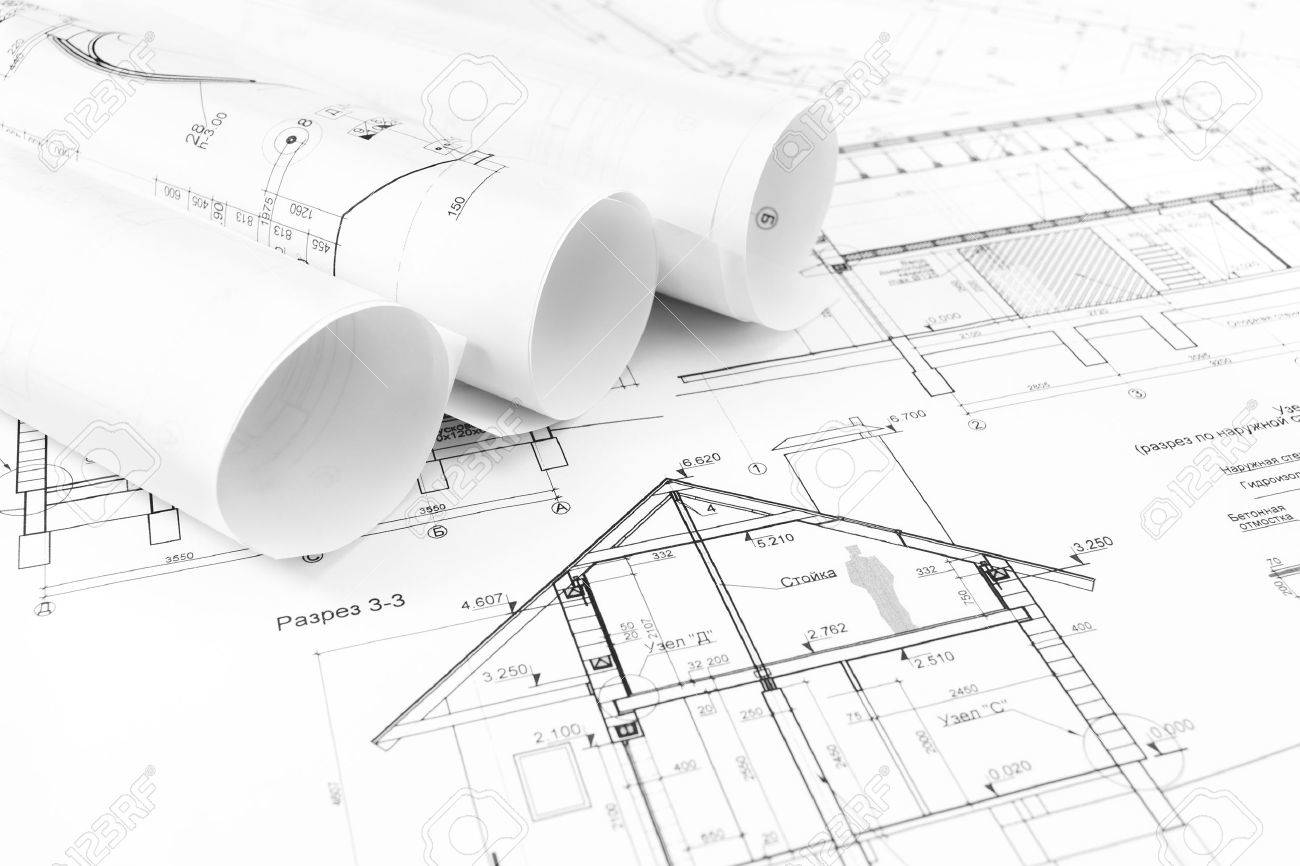 architectural engineering blueprints. Rolls Of Architectural House Plans And Engineering Blueprints Stock Photo - 27077788