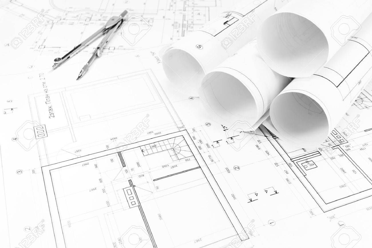 Architectural Background With Floor Plans And Rolls Of Technical