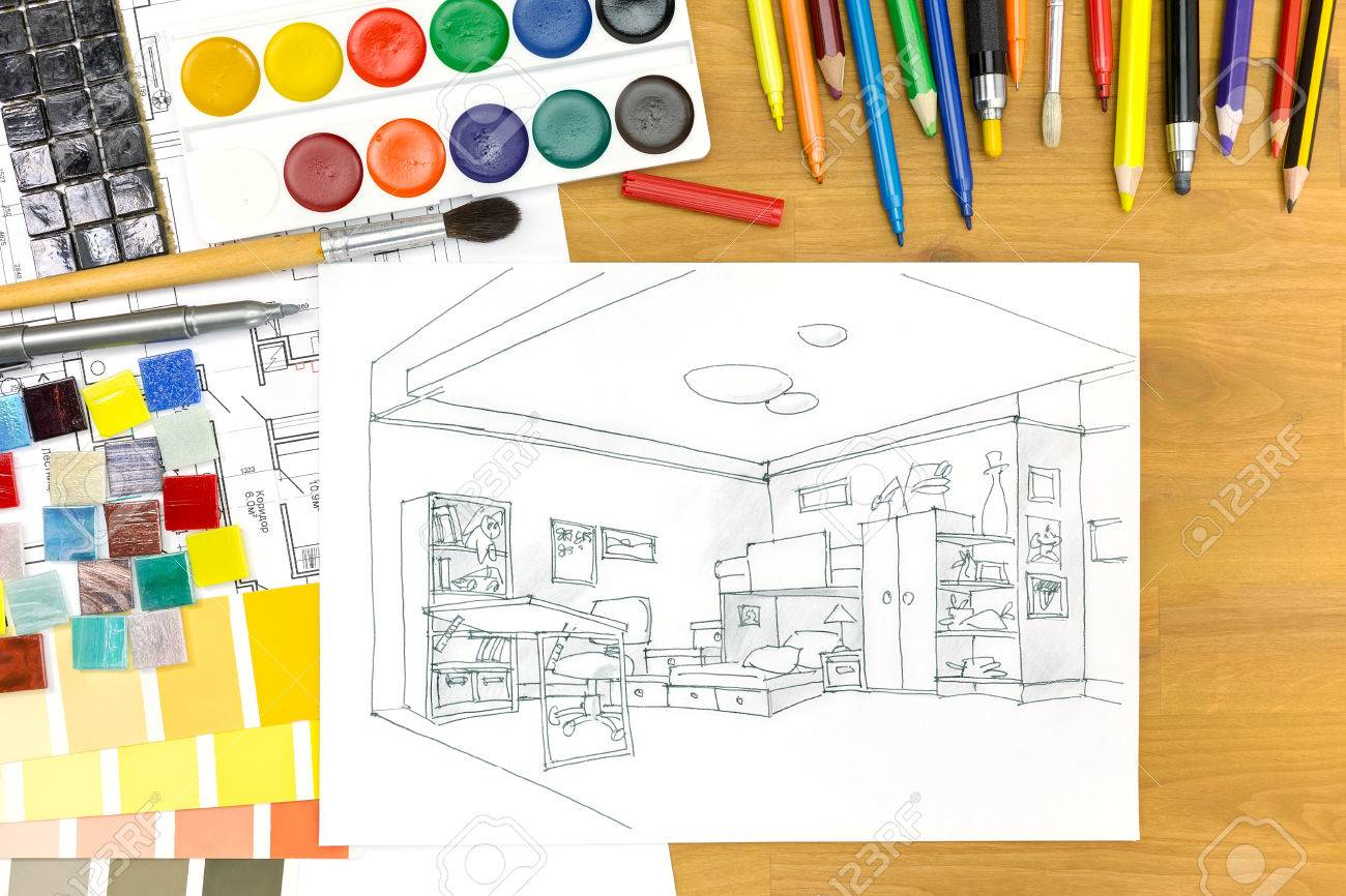 Interior Designers Desk With Architectural Tools And A Kids Room Sketch Stock Photo
