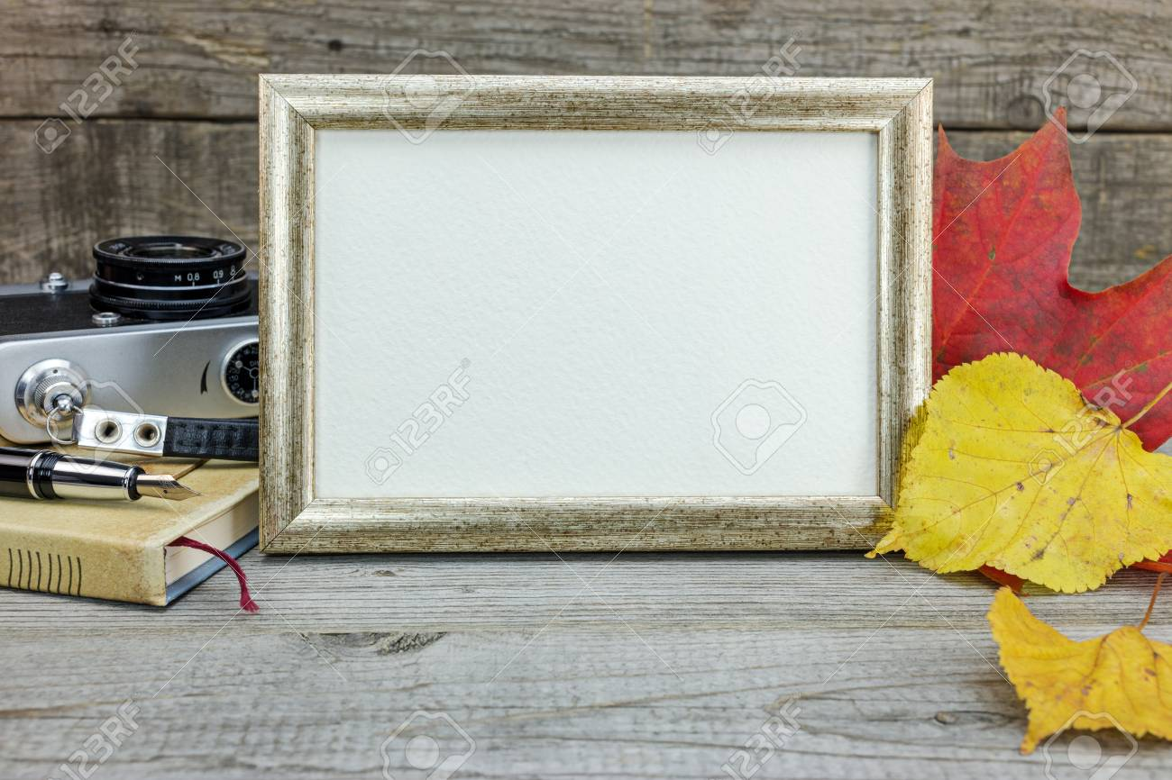 Wooden Table Background With Vintage Camera, Photo Frame, Notebook ...