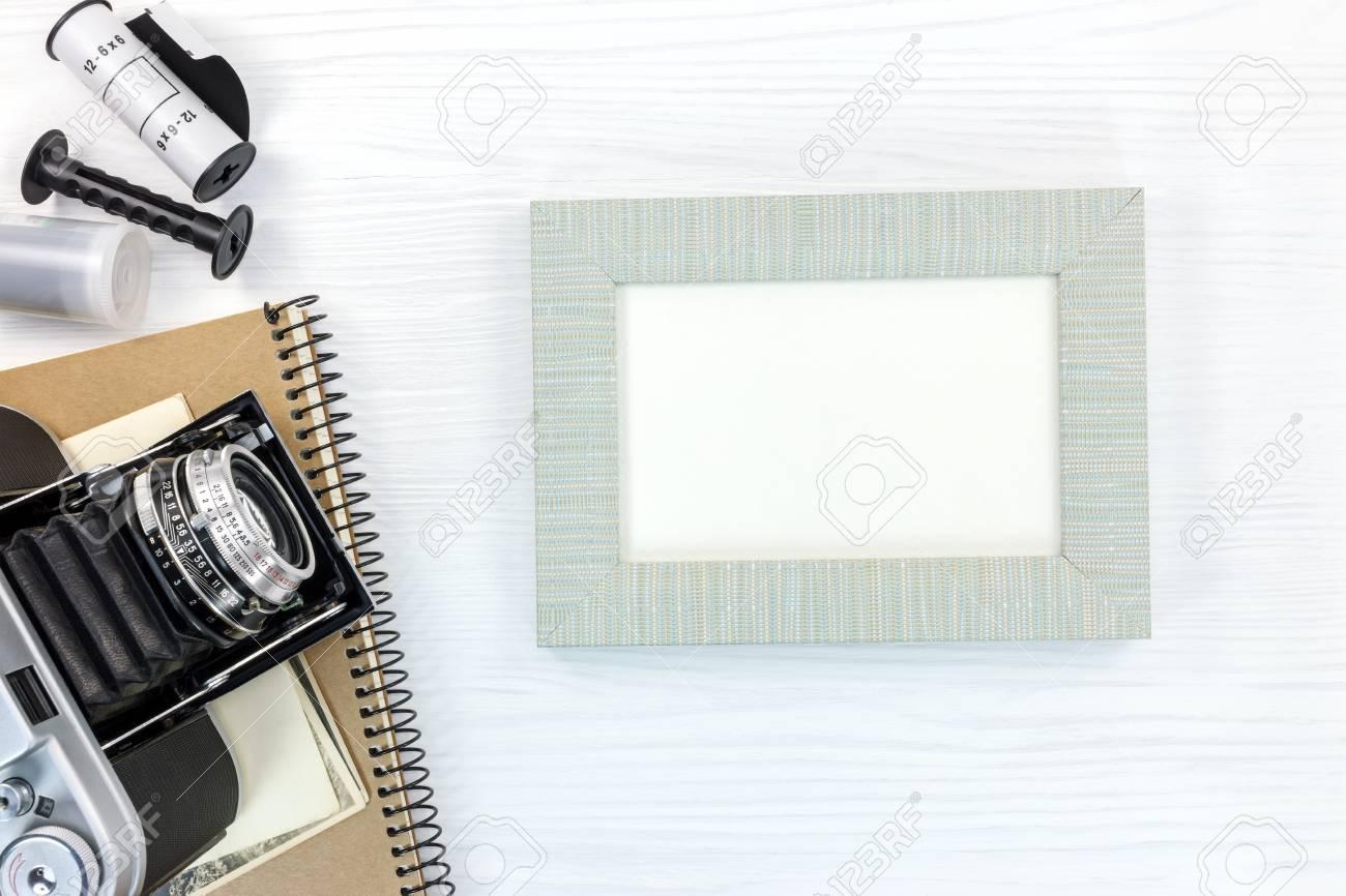 Retro Camera, Notebook, Negative Film Rolls And Grey Photo Frame ...