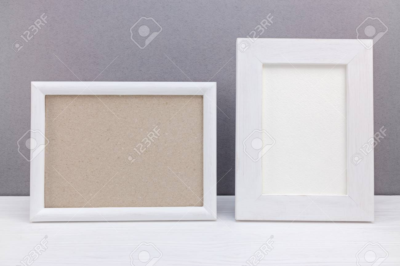 Horizontal And Vertical White Wooden Empty Photo Frames On Grey ...