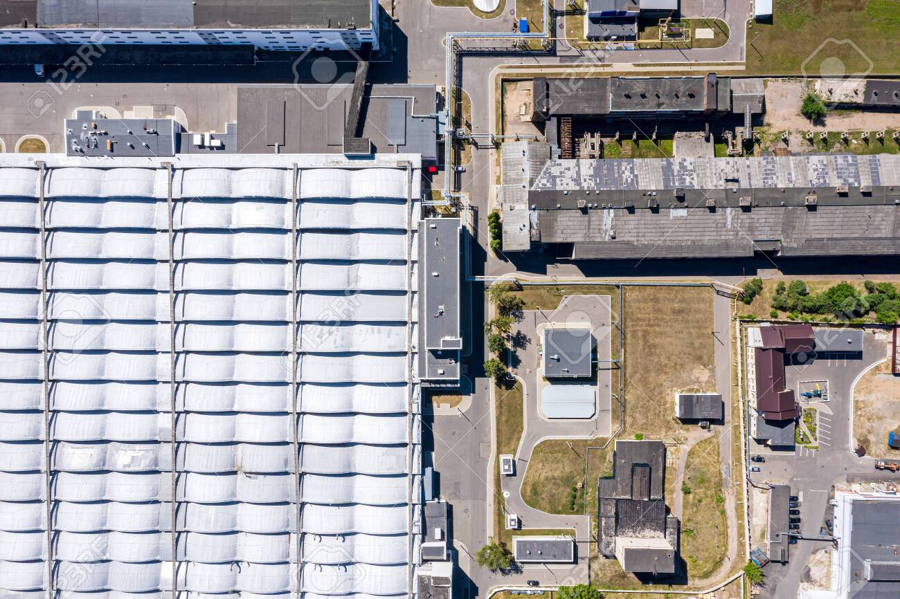 Aerial Top View Of City Industrial Area And Part Of Roof Of Modern Stock Photo Picture And Royalty Free Image Image 127647958