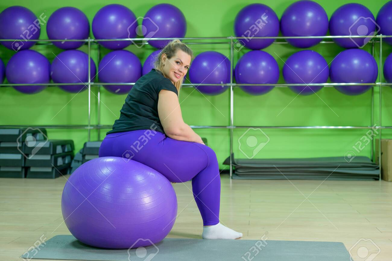 A Fat Woman Is Engaged In The Gym And Trying To Lose Weight Stock Photo Picture And Royalty Free Image Image 135662710