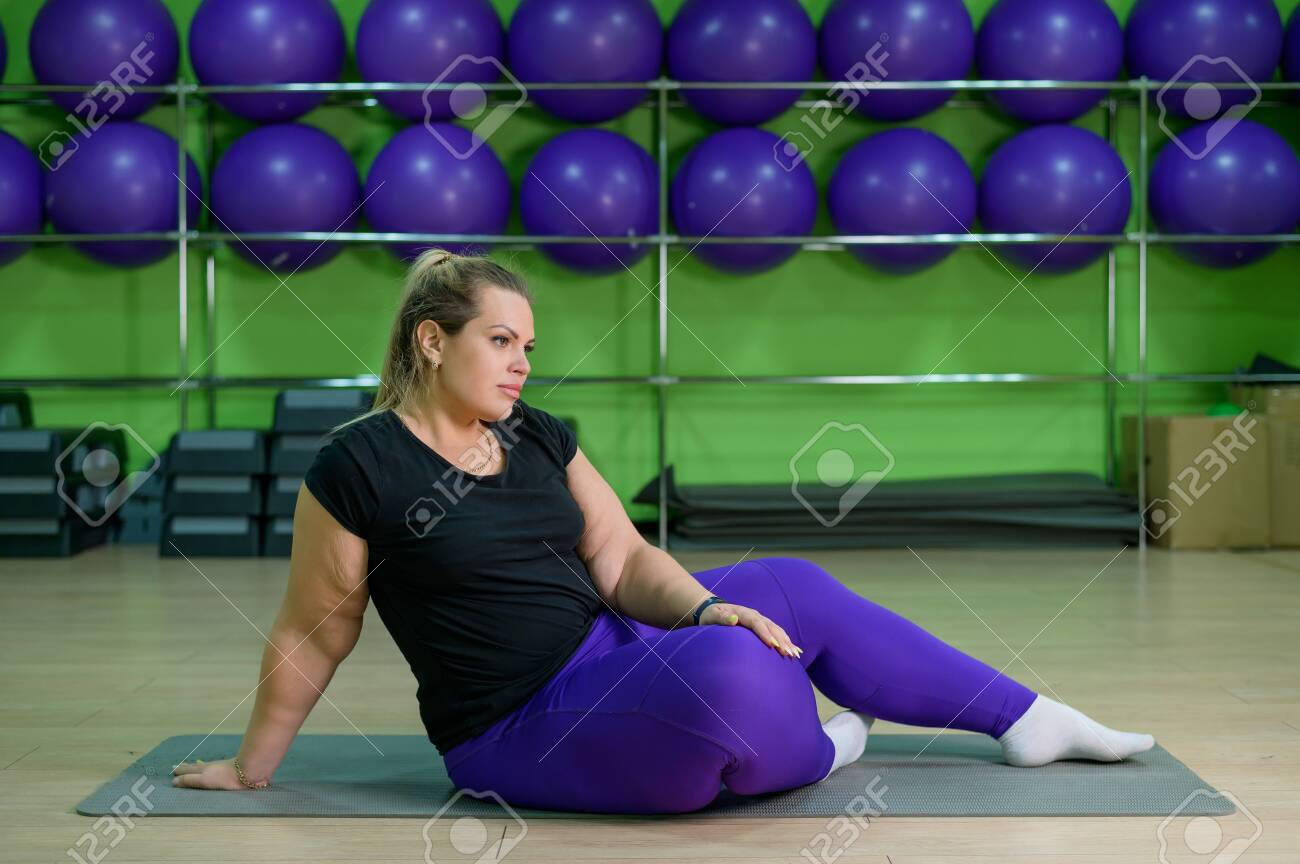 Overweight Woman Overweight Doing Fitness With Ball Obese Blonde Stock Photo Picture And Royalty Free Image Image 140206633