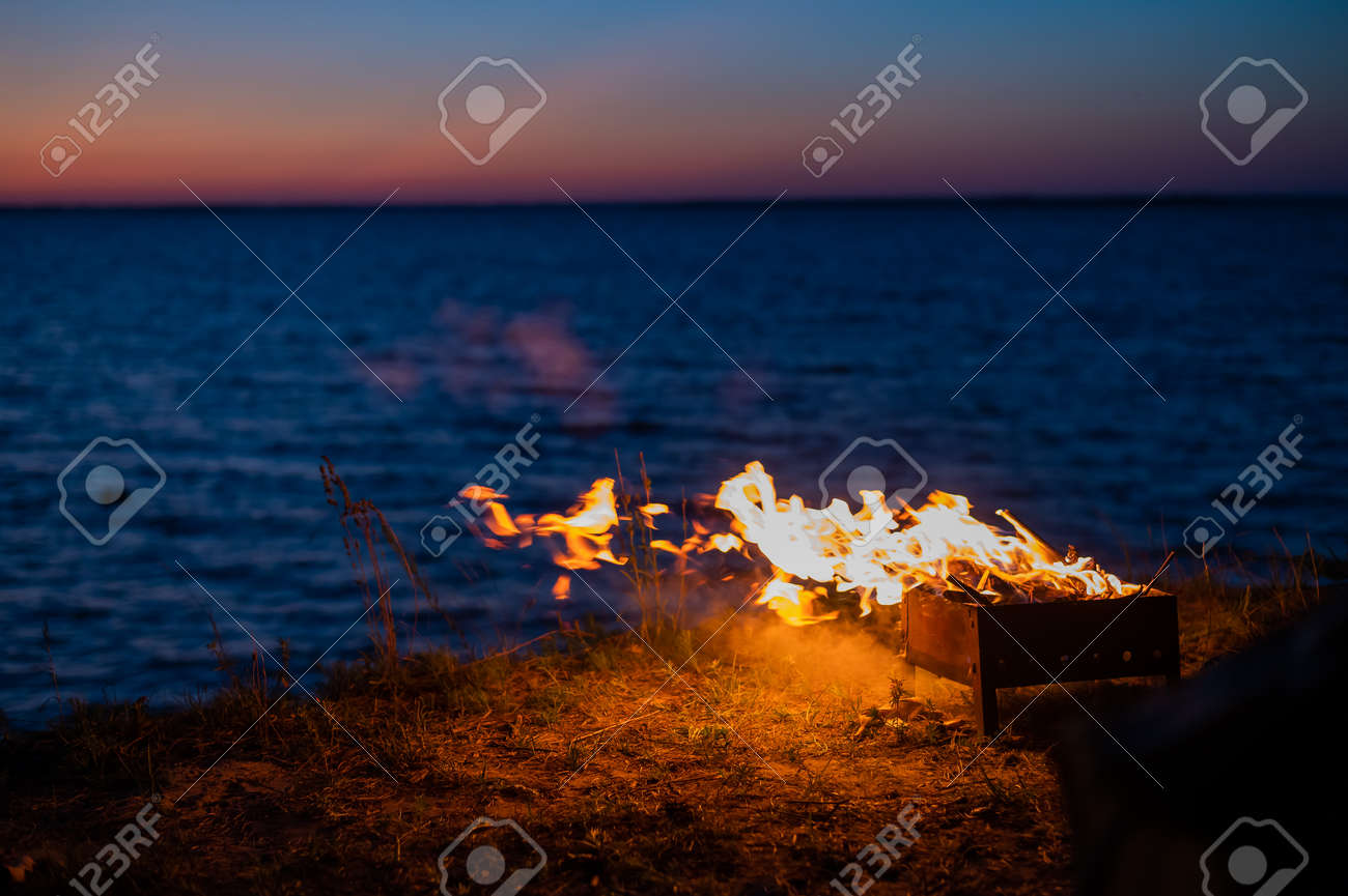 View from a tourist tent on bonfire on the seashore at sunset - 169522665