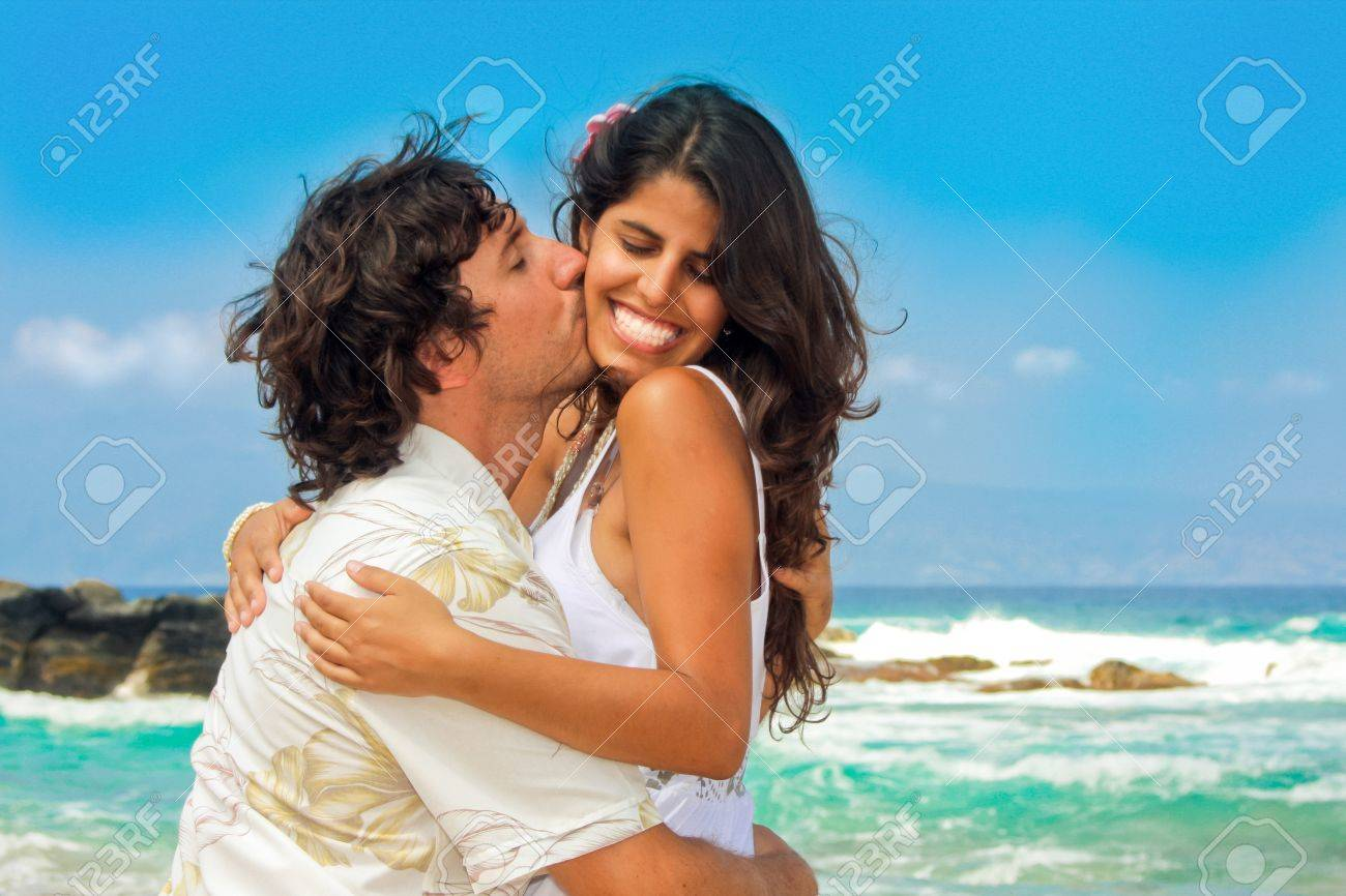 Attractive couple on the beach Stock Photo - 8461325
