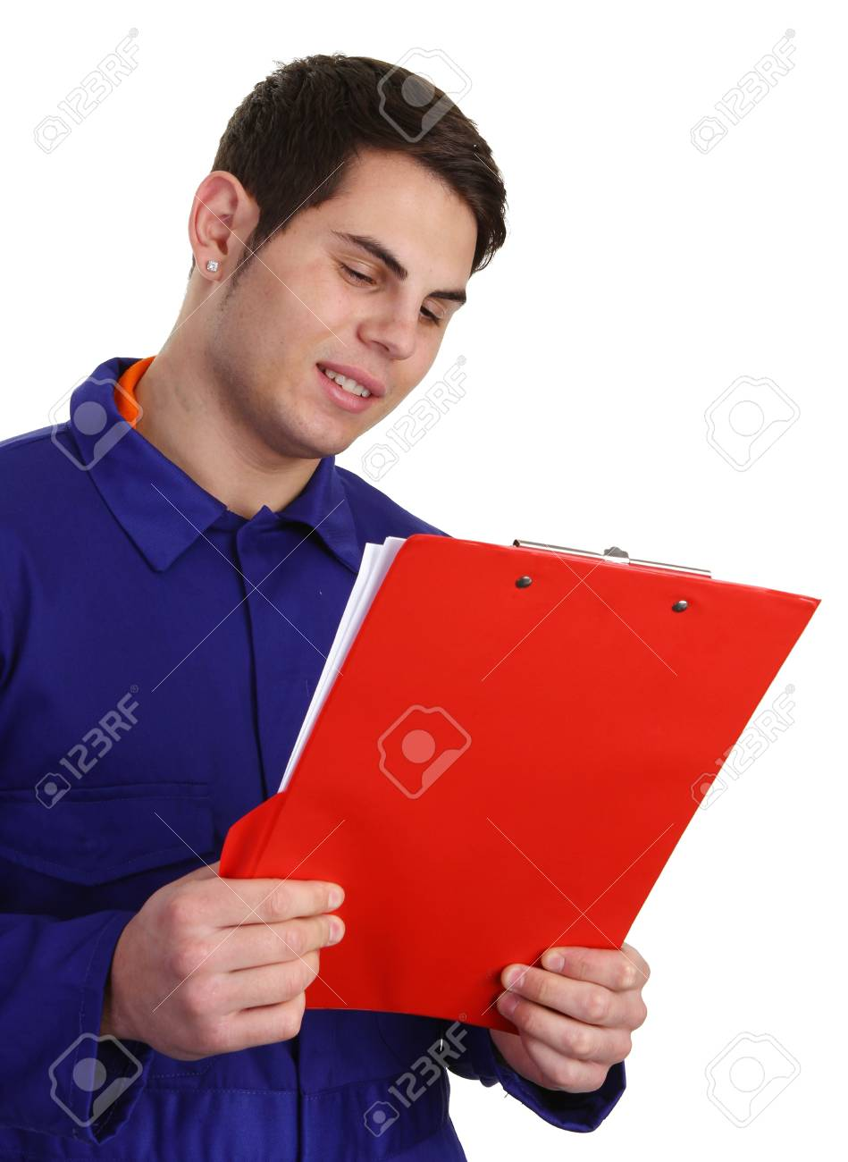 A guy in blue boilersuit looking at a clipboard Stock Photo - 11324047