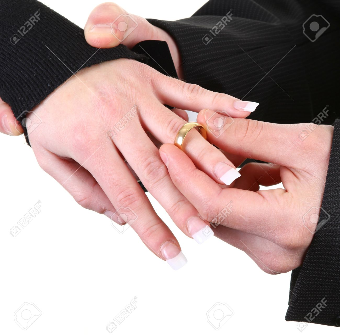 A Guy Putting A Ring Onto A Girls Hand Stock Photo, Picture And ...