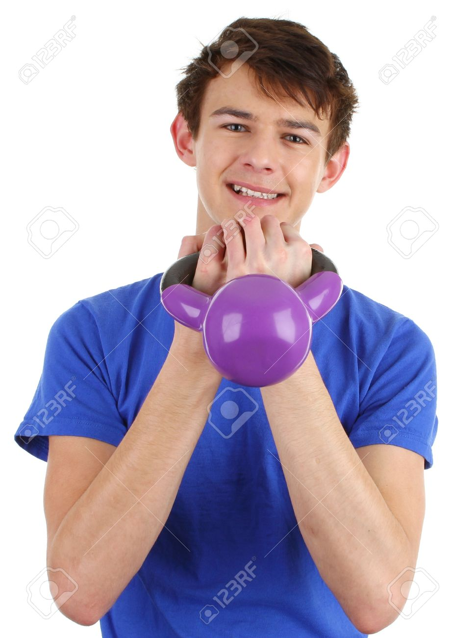 A guy holding a dumbell close to his chest working out. Stock Photo - 11773034