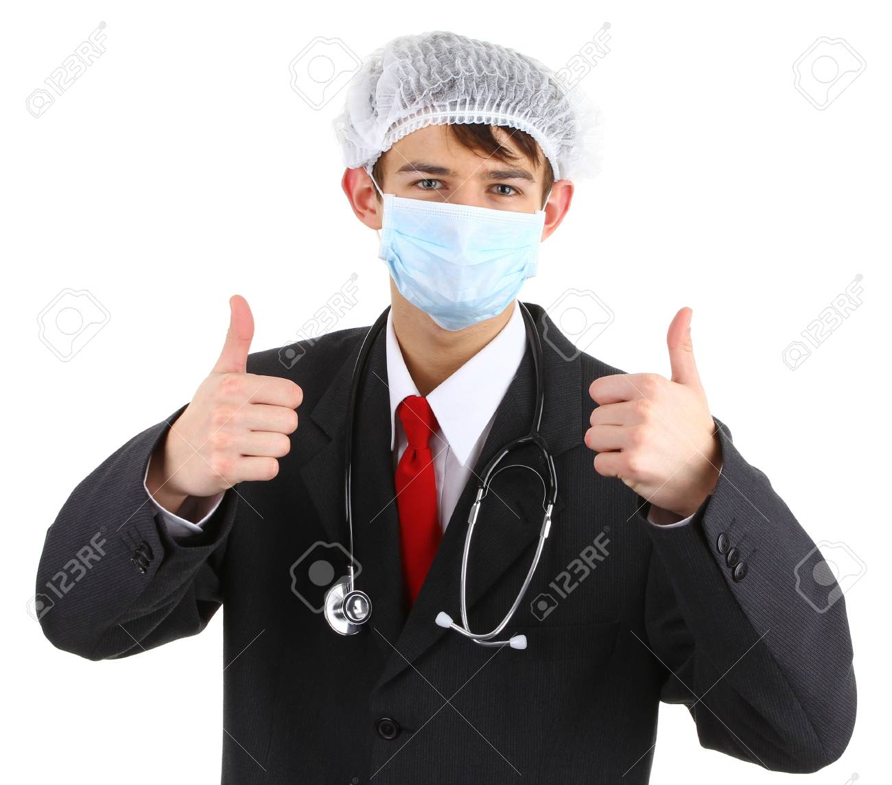 A doctor with a thumbs up sign, isolated on white Stock Photo - 12504229