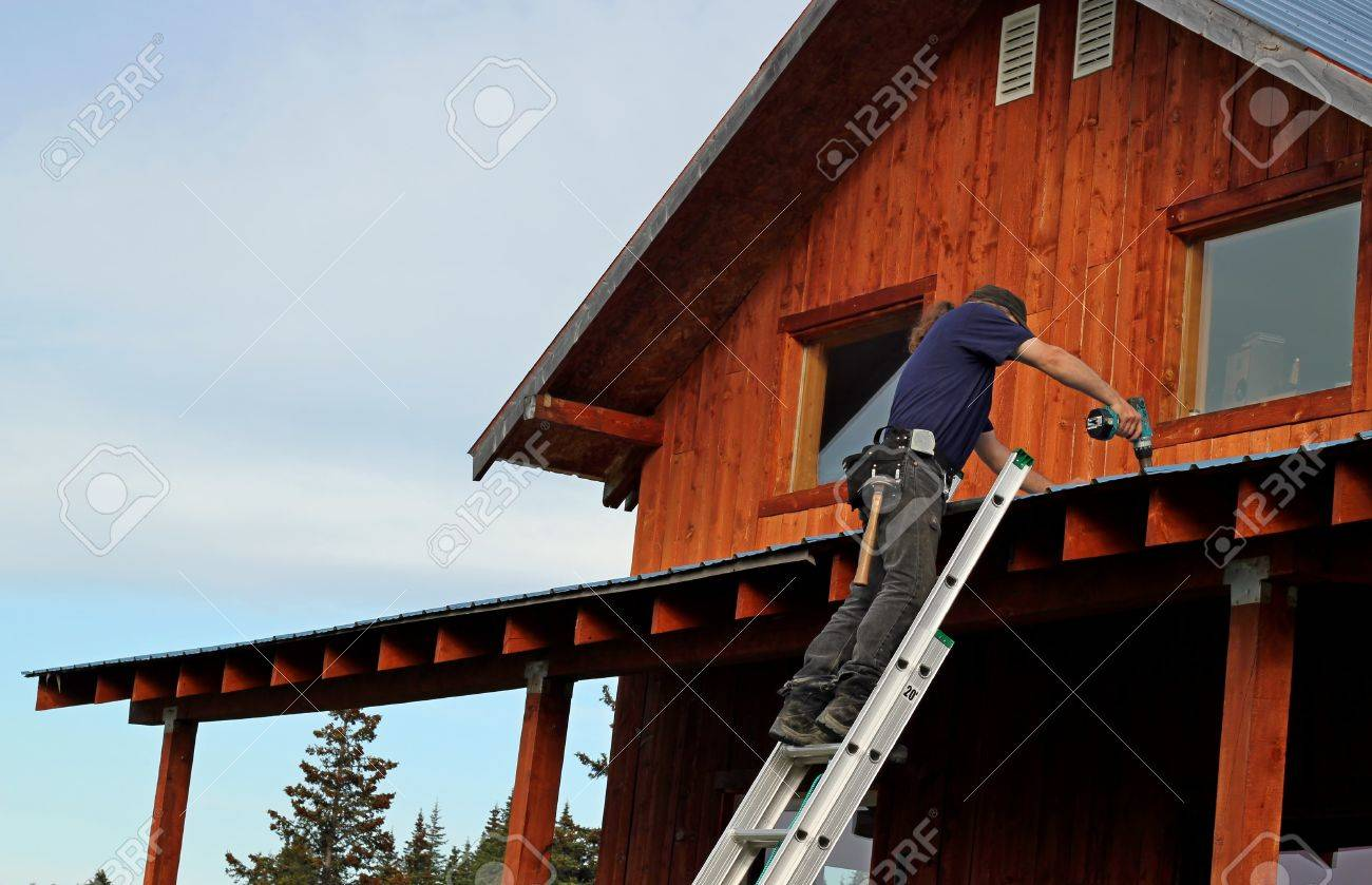 Man on a ladder performing repairs to a metal roof. Stock Photo - 11117046