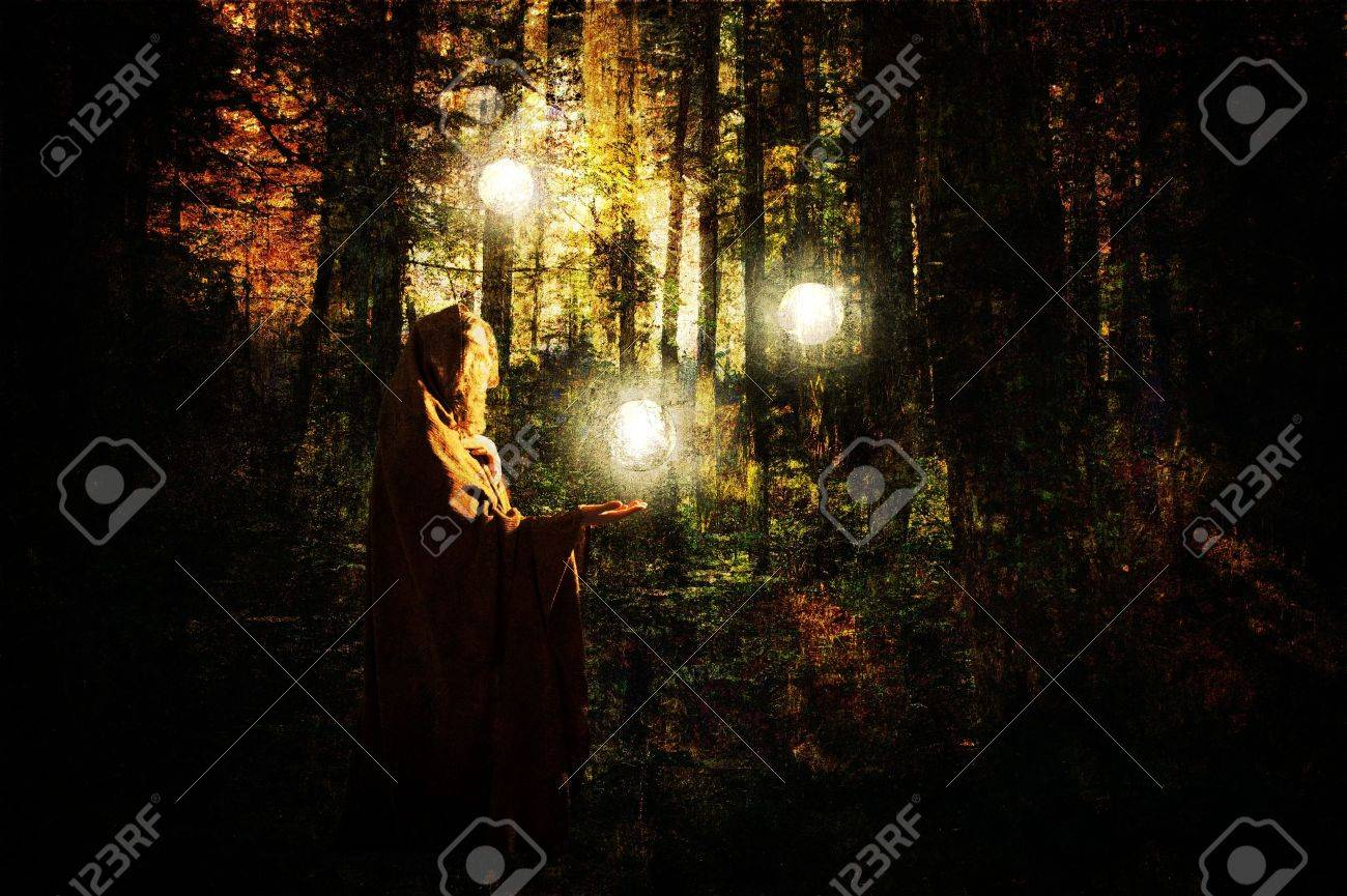 Fantasy scene with a caped woman in a forest with glowing balls of light created with texture layers. Stock Photo - 13165749