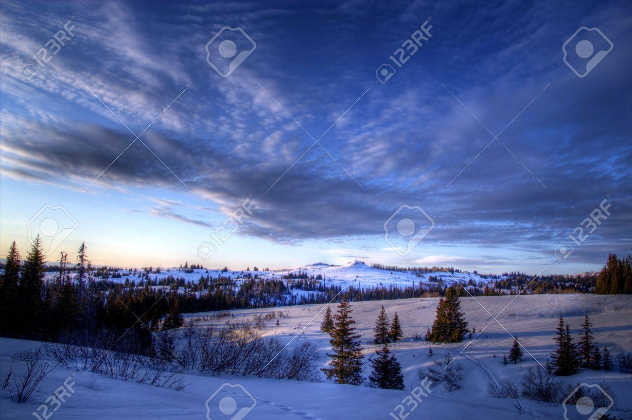 Streaming clouds in the evening sky in rural Alaska in winter. Stock Photo - 13300209