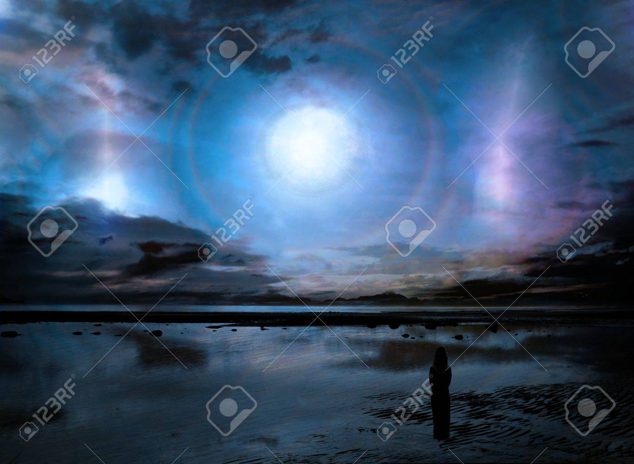 Surreal fantasy scene with a strange light phenomenon in the sky over a beach landscape and a woman in silhouette looking out at it. Stock Photo - 13447012