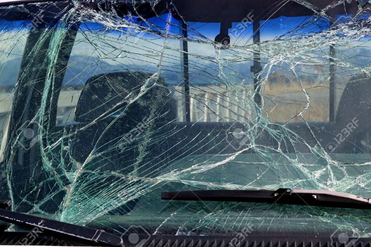 Broken car windshield glass in a car after an accident. Stock Photo - 13565282