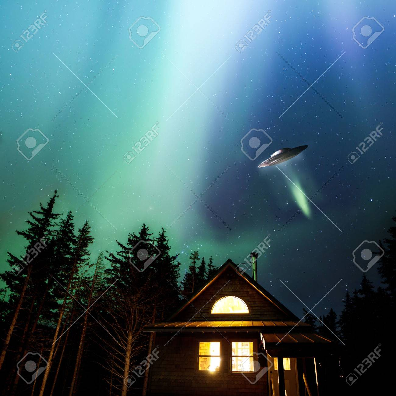 UFO flying over an Alaskan cabin with colorful nothern lights in the night sky. Stock Photo - 24603674