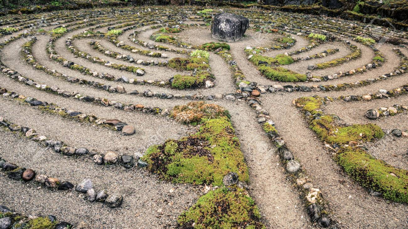Old labyrinth meditation maze of stone. Stock Photo - 58212216
